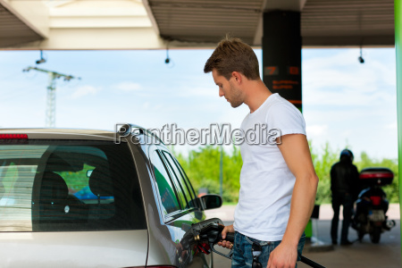 refuel with car at gas station