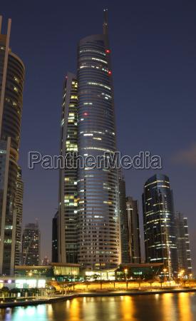 skyscraper at night in jumeirah lakes