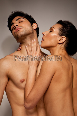 topless couple in loving foreplay