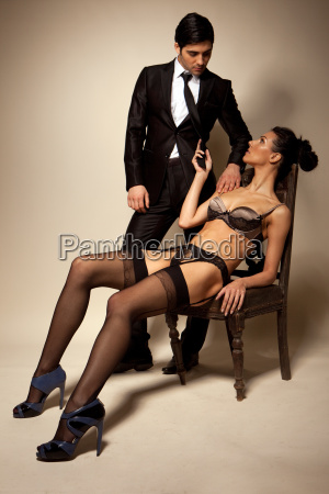 businessman and sexy lady in lingerie