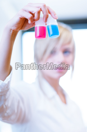 female researcher carrying out experiments in