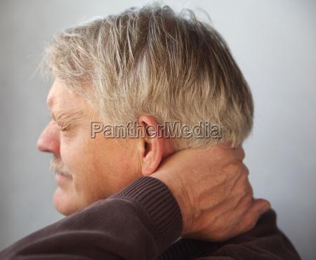 senior man with aching neck