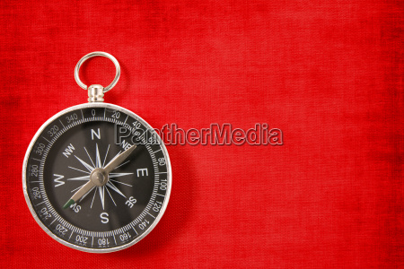 compass on the vivid red background
