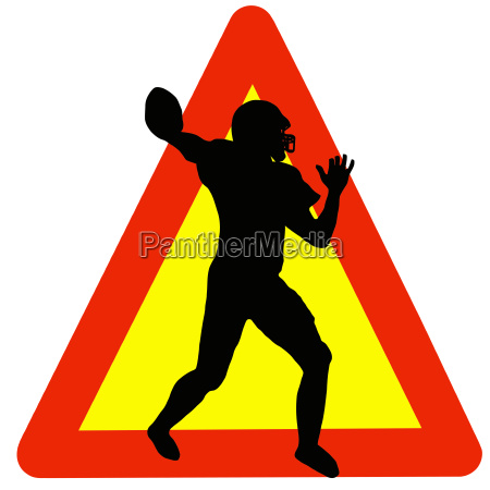 football player silhouette on traffic warning