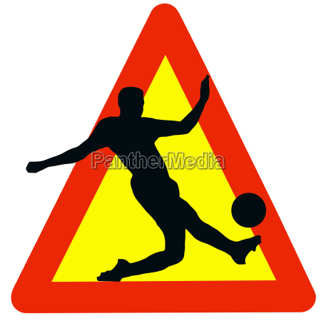 soccer player silhouette on traffic warning