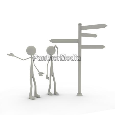 zwei figuren stehen vor einem wegweiser