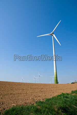 windmills and an uncultivated field