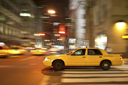 taxi at night blurred with motion