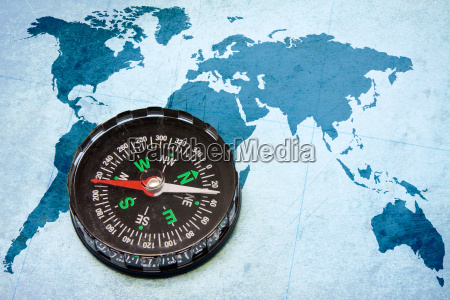 compass on the blue world map