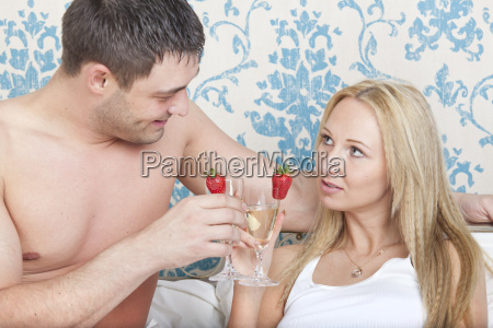 couple drinking in bed