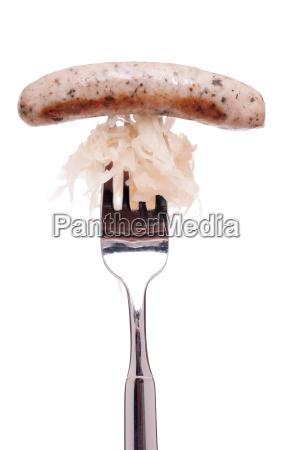 nuernberger bratwurst mit sauerkraut und gabel