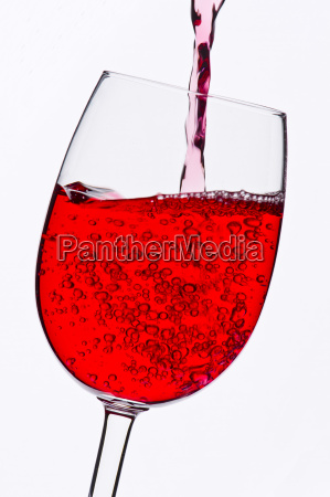 red wine glass in backlight
