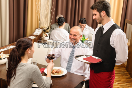 business lunch executives toasting with red