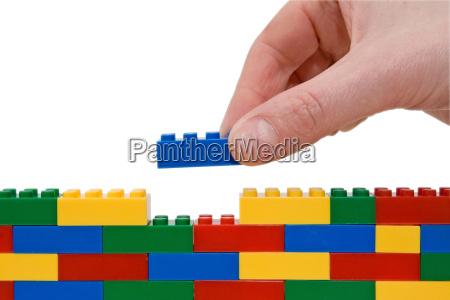 hand gebaeude lego