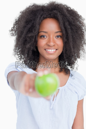 smiling young woman holding a delicious