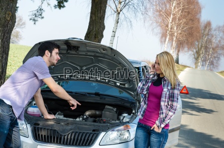 car breakdown couple calling for road