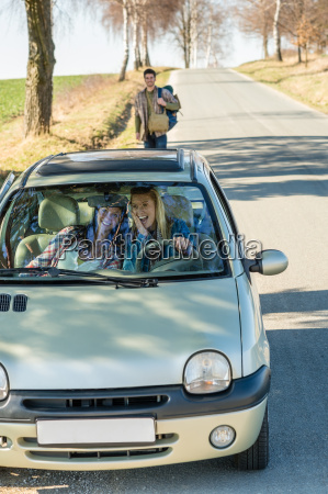 exciting girls drive car taking hitch