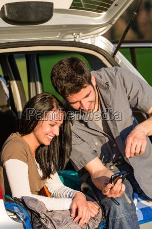 camping car happy couple look camera