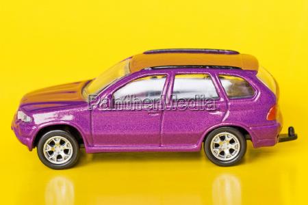 purple car on yellow background