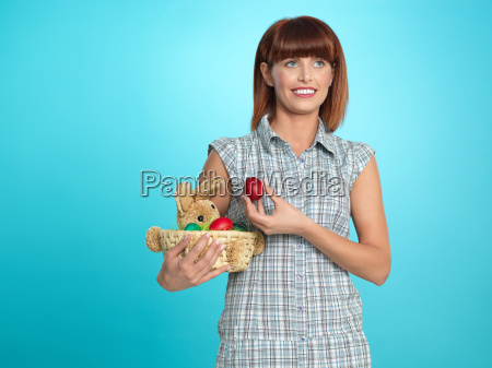 attractive young woman holding easter eggs