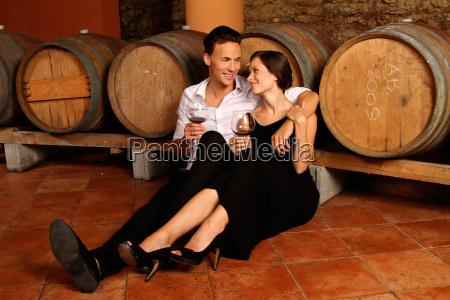 couple in wine cellar