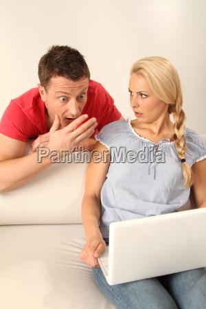 a couple on a laptop