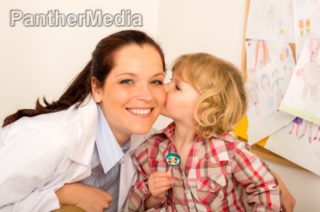 pediatrician woman get kiss from child