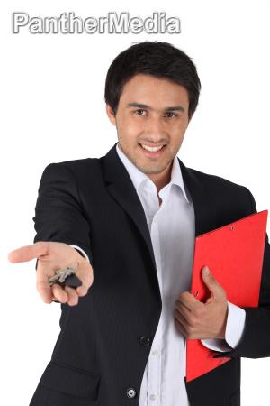 estate agent handing over keys to