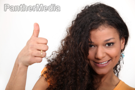 woman with curly hair giving the