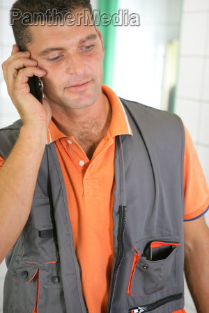 plumber making call from bathroom