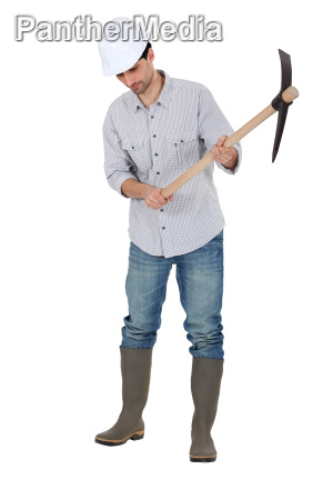 a construction worker with a pickaxe