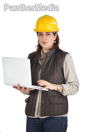 female construction worker using her laptop