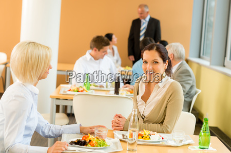 cafeteria lunch young business women eat