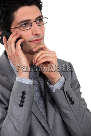 thoughtful businessman using a cellphone