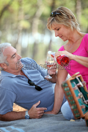 middle aged couple having fancy picnic
