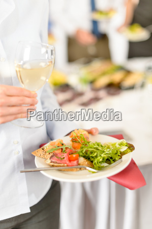 business woman hold plate with catering
