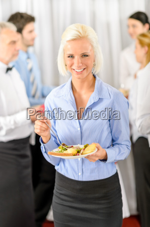smiling business woman during company lunch