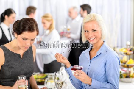 business meeting buffet smiling woman eat