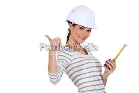 tradeswoman giving the thumbs up