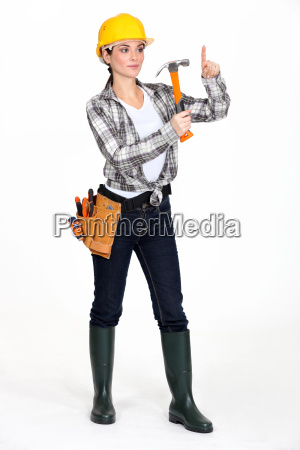 apprehensive woman using hammer