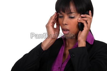 office worker receiving bad news over