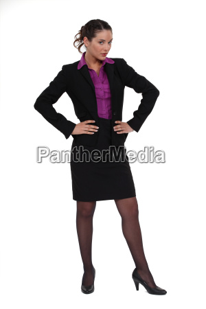 businesswoman standing with her hands on