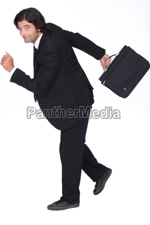 businessman rushing to go to work