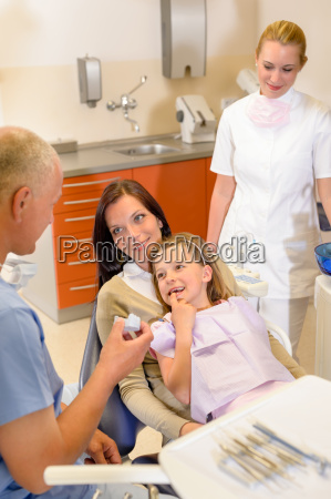 little girl visit dentist surgery with