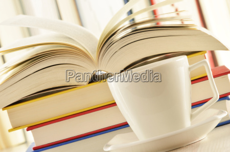 composition with stack of books and