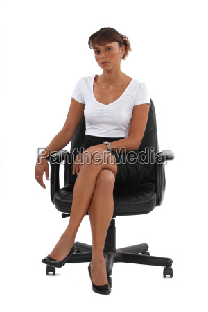 businesswoman sat in office chair