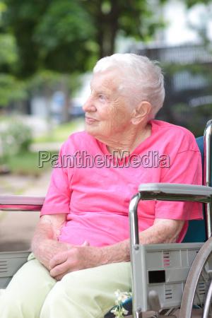 senior woman in rollstuhl