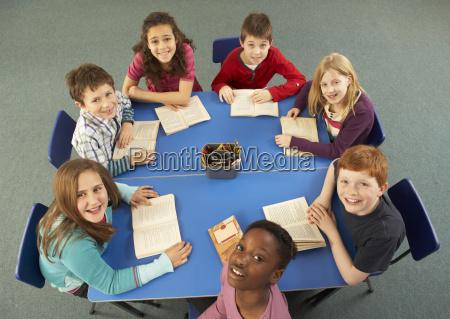 overhead view of schoolchildren working together