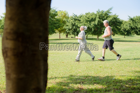active senior people jogging in city