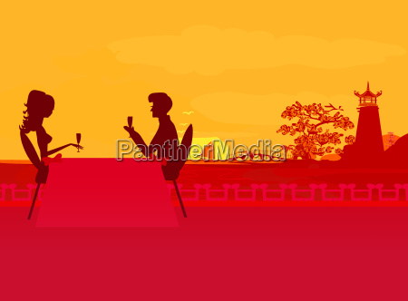 silhouette couple flirt and drink on